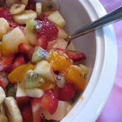 Sunday Best Fruit Salad Recipe - Several steps build to the final salad crescendo. Chopped apples and bananas marinate in pineapple juice, and kiwi and strawberries are sliced. Then everything is mixed into peach pie filling and spooned into a beautiful serving bowl.