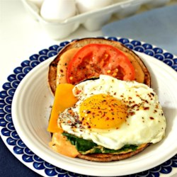 Cajun Fried Egg Sandwich Recipe - Egg, Cheddar cheese, tomato, and lettuce are seasoned with Cajun seasoning in this Cajun fried egg sandwich recipe.
