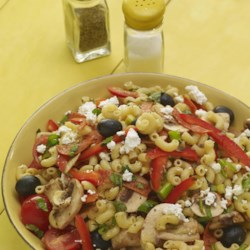 Greek Pasta Salad I Recipe - Taste the earthy flavors of the Mediterranean in every bite of this colorful summer salad. Tangy feta cheese, fresh mushrooms, tomatoes, onions, bell peppers and olives are tossed with spicy pepperoni and macaroni in an herb-infused vinaigrette.