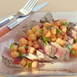 Tuna Steaks with Melon Salsa Recipe - Pan-fried tuna steaks are served with a fresh melon salsa with hot chilies, basil, and lime juice for a delightful way to serve fresh tuna.