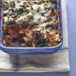 Rita's Spinach Casserole Recipe - This is a quick and delicious way to get kids to eat spinach! Ground beef and tomato sauce are layered in a casserole with spinach and mozzarella cheese.