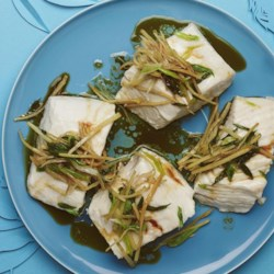 Authentic Chinese Steamed Fish Recipe - A whole rockfish is steamed until it's flaky and moist; hot oil flavored with ginger and green onions is then poured overtop to crisp the skin.
