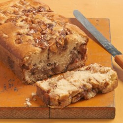 Apple Cinnamon White Cake Recipe and Video - Apples and cinnamon are layered into cake batter and baked into a delightfully sweet loaf cake that is a nice dessert accompanied by a scoop of vanilla ice cream.