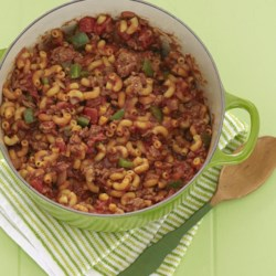 Goulash Supreme Recipe and Video - Macaroni is cooked in a spicy tomato sauce flavored with onions, garlic, paprika and chili powder. Add cooked ground beef to make a hearty, satisfying meal.