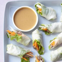 Steak Summer Rolls Recipe - Flat-iron steak, homemade pickled vegetables, and cilantro are wrapped in a rice wrapper in this refreshing spring roll recipe.