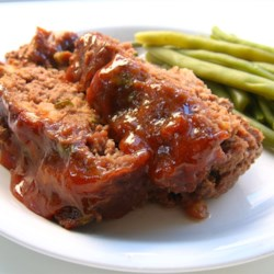 Glazed Meatloaf II Recipe and Video - This meatloaf's flavor is enhanced with beef bouillon and a brown sugar glaze with a hint of lemon juice.