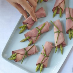 Black Forest Ham and Asparagus Bundles Recipe - Black Forest ham and asparagus bundles are a quick and easy appetizer that are always a hit at parties and get-togethers.