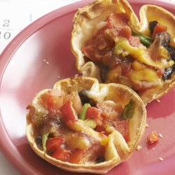 Antojitos Minis Recipe - These little Mexican inspired appetizers are easy to prepare and the many ingredients may be varied according to taste. Try layering the cheeses and vegetables in different variations for a colorful and exciting platter.