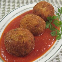 Jan's Brown Rice and Quinoa Cheesy Rice Balls Recipe - Cooked rice mixed with lots of cheese is rolled into balls, breaded, and pan fried in a delicious twist on fried mozzarella sticks.