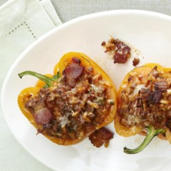 Bolognese Stuffed Bell Peppers Recipe - A rich Italian-style meat and tomato filling is mixed with rice or orzo, and baked in bell peppers.