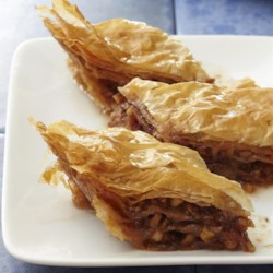 Yia Yia's Baklava Recipe - This traditional, delicious baklava has layers of tender phyllo dough with a walnut filling, and is coated in a spiced syrup.