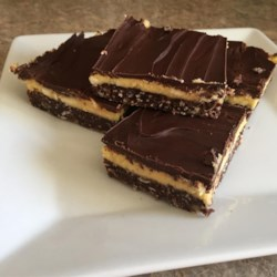 Nanaimo Bars III Recipe - Because it's three layers, this sounds hard but it's worth it.  My son is famous for making and taking these in to work.  I've heard other names but here in the Northwest everyone knows them as Nanaimo bars. They are sold on British Columbia Ferries and at coffee stands. If you can't find custard powder, I've used instant pudding mix with good results.