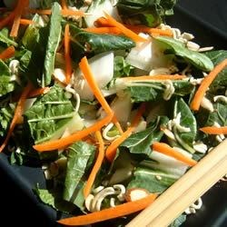 Bok Choy Salad Recipe - Three parts to this crunchy and refreshing salad. A cabbage and green onion part ...a ramen noodle, toasted almonds and sesame seed part ...and a yummy seasoned lemon juice and oil part.  Bring them together and you have the fabulous Bok Choy Salad.