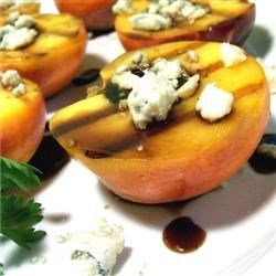 Grilled Peaches Recipe - This is a deliciously simple end to a grilled meal. Peaches are grilled with a balsamic glaze, then served up with crumbled blue cheese. A sophisticated, extremely simple recipe that's perfect for summer entertaining!