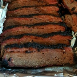 Holly's Texas Brisket Recipe - This Texas-style beef brisket is seasoned with a blend of spices, then slow-cooked on a grill and in an oven to juicy, tender perfection.