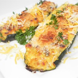 "Zucchini Slippers Recipe - Zucchini stuffed with cottage cheese, red bell pepper, and Colby cheese, also known as zucchini ""slippers"", is a quick and easy appetizer or side dish."