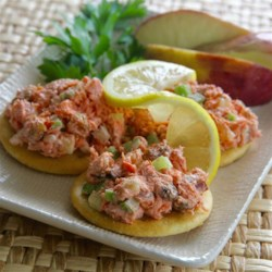 Fruity Red Salmon Salad Recipe - Red salmon is complemented with golden raisins and apples and given a kick with crushed red pepper flakes. Serve on bagels, whole wheat toast or whole wheat saltines.