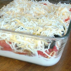 Delicious Dip Recipe - Smooth and creamy, this dip is layered with cheese, picante sauce and vegetables.
