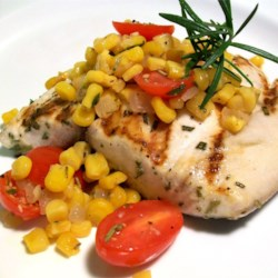 Rosemary Marlin with Roasted Corn and Tomato Relish Recipe - Grilled marlin seasoned with an olive oil and fresh rosemary marinade is accompanied by an easy, oven-roasted relish starring summer-fresh corn, onions, garlic, and cherry tomatoes.