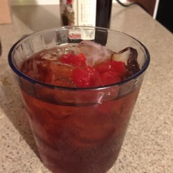 Red Hot Manhattans Recipe - Cinnamon whiskey makes a Manhattan cocktail that will warm you up starting with your toes.