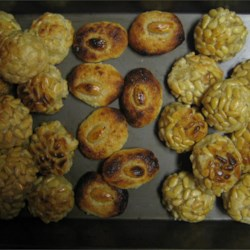 Panellets - Catalan Potato Cookies Recipe - These cookies are traditionally served for All Saints Day on November 1st, in Catalonia.  Pine nuts can be substituted for the chopped almonds.  Cocoa powder or chocolate drink mix can also be added to the mixture to change the taste. And yes, they are supposed to be squishy when you eat them.