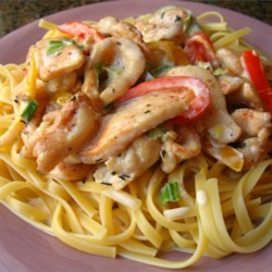 Cajun Chicken Pasta Recipe - Chicken dredged in Cajun spices is sauteed with bell peppers and mushrooms, and presented in a basil-cream sauce over linguine.