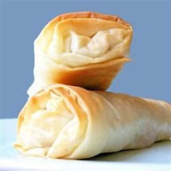 Moroccan Meat Cigars Recipe - Spiced ground beef is rolled up in phyllo sheets then baked. These make great appetizers and hummus is a perfect accompaniment.