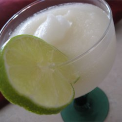 Margaritas Recipe and Video - Frozen margaritas are made with limeade concentrate, tequila, triple sec, and ice.