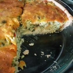 Easiest Zucchini Quiche Recipe - Zucchini, eggs, Cheddar cheese, and a frozen pie crust are all you need to make this satisfying brunch dish.