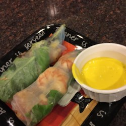 Lobster and Avocado Summer Roll with Mango Coulis Recipe - This Asian fusion recipe pairs great summertime flavors of mango and avocado together with lobster. Try to get Haas avocados if possible. Slipper, spiny, rock, or Maine lobster would all work in this recipe.