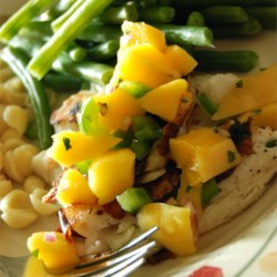 Grilled Tilapia with Mango Salsa Recipe - Don't let the list of ingredients fool you: this is super-easy, and gets rave reviews whenever I serve it. The salsa can be made the day ahead to save time.