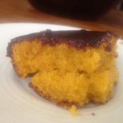 Brazilian Carrot Cake Recipe - The Brazilian version of carrot cake is made as a sheet cake with plenty of grated carrots, and topped with a chocolate icing.