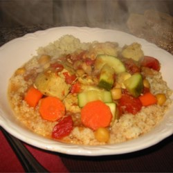 Moroccan Chicken and Whole Grain Couscous Recipe - A flavorful chicken stew that uses exotic spices and nice vegetables served over whole-grain couscous. This recipe was actually a real chicken contest winner!