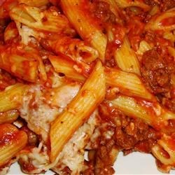 Baked Pasta Recipe - Warm up a chilly evening with this hearty bake of ground beef and ziti pasta in a tasty tomato cream sauce flavored with brown gravy, half-and-half, dried spices and two kinds of cheese.