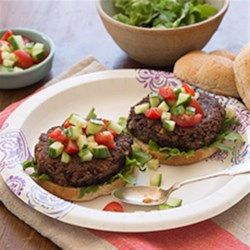 Smoky Black Bean Burgers Recipe - Black beans, flax meal, and liquid smoke make these veggie burgers a flavorful substitute for hamburgers on the grill. Serve on buns with your favorite condiments.
