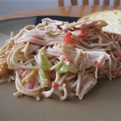 Chicken Chile Spaghetti Recipe - A homey casserole of cooked chicken, spicy tomatoes, veggies, processed cheese, and vermicelli is baked until golden brown. It also works in the slow cooker.