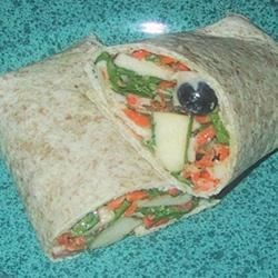 Fruit, Veggie, and Tuna Salad Wrap Recipe - Spinach and tuna salad wraps get a light, fruity flavor from apples and blueberries for a quick and easy summer lunch.