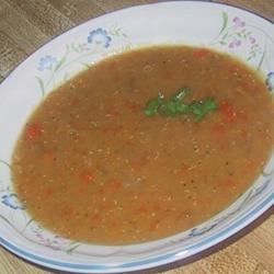 Favorite Lentil Soup Recipe - Red lentils are colorful and creamy in this Middle Eastern-inspired soup. A fragrant mix of olive oil, onion soup mix, ground cumin, and pepper provide zip! The lentils are cooked in a pressure cooker, then combined with herbs and spices and processed until smooth. Just before serving, a squeeze of lemon and a sprinkling of parsley are added.