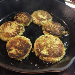 Plantation Ham Cakes Recipe - Ground ham, onions and broccoli are melded with cornmeal, Asiago cheese, eggs, garlic and a sprinkling of dried basil and anise seed, to make tender fried patties for a post-holiday brunch.
