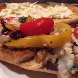 Mediterranean Chicken Sandwich Recipe - Tender chicken is cooked with garlic, bell pepper, onion, kalamata olives, and capers, then piled into hoagie buns with melty mozzarella and feta cheeses.