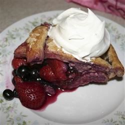 Mixed Berry Pie with Honey Whole Wheat Crust Recipe - This is a delicious pie that includes blueberries, boysenberries, and strawberries all housed in a hearty whole wheat crust!