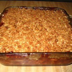 Apple Cranberry Crisp Recipe - A great combination of apples and cranberries with a crispy topping. A favorite at Thanksgiving instead of plain cranberries.