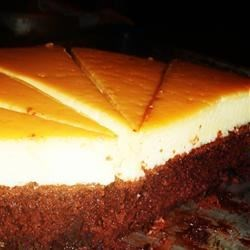 Flan I Recipe - This is a wonderful flan recipe from the late Iris Perez. Its origin is Mexican.  For a denser, cheesecake-like texture, substitute eight ounces of cream cheese for two of the eggs.