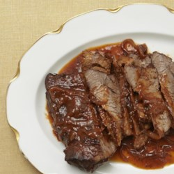 Wine-Braised Beef Brisket Recipe - Tender beef brisket roasts for hours until tender in an easy, savory sauce flavored with tomato and red wine.