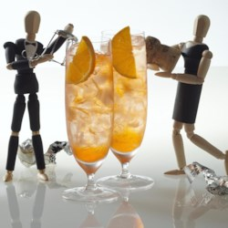 Aperol(R) Spritz Recipe - Aperol(R) poured over a glass of iced Prosecco is a refreshing 'spritz' at happy hour.