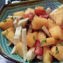 Jicama and Melon Salad Recipe - Jicama and Honeydew melon feature prominently in this fresh salad bringing fruit and vegetable together for a tangy treat.