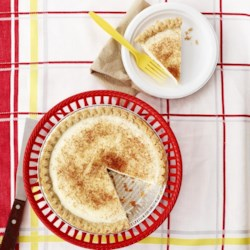 Sugar Cream Pie I Recipe - A homemade vanilla pudding is poured into a baked pie shell, drizzled with melted butter and cinnamon, and then popped under the broiler until the topping is bubbly.