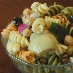 Greek Pasta Salad Recipe - This pasta dish has all the refreshing flavors of a classic Greek salad with tomatoes, cucumber, olives, and feta cheese.
