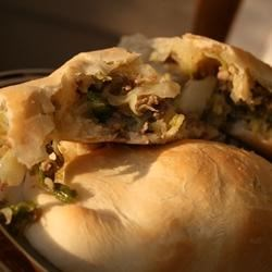 Runzas II (Bierocks) Recipe - Ground beef, onions, and cabbage wrapped in bread dough and then baked.