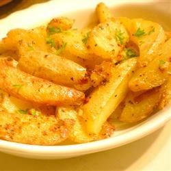 Oven Fresh Seasoned Potato Wedges Recipe - Oven fries seasoned with garlic powder and onion powder will go great with your favorite burgers.